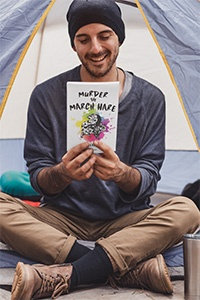 book-mockup-featuring-a-joyful-man-sitting-in-a-camping-tent-30479_200