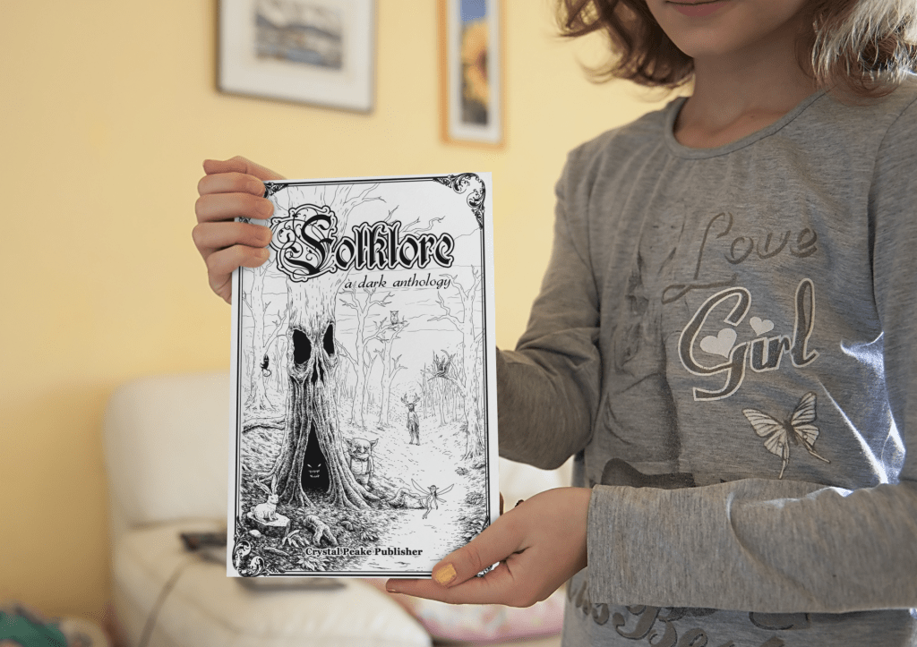 mockup-of-a-little-girl-showing-the-cover-of-a-book-3444-el1-2